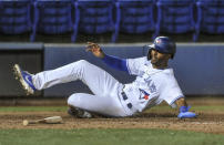 Toronto Blue Jays' Josh Palacios scores on Joe Panik's single off Los Angeles Angels reliever Aaron Sloggers during the eighth inning of a baseball game Saturday, April 10, 2021, in Dunedin, Fla. (AP Photo/Steve Nesius)