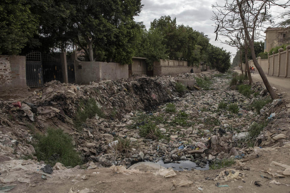 Trash fills a water canal in an impoverished area where people have been greatly affected by the coronavirus outbreak, in Cairo, Egypt, Thursday, April 9, 2020. (AP Photo/Nariman El-Mofty)