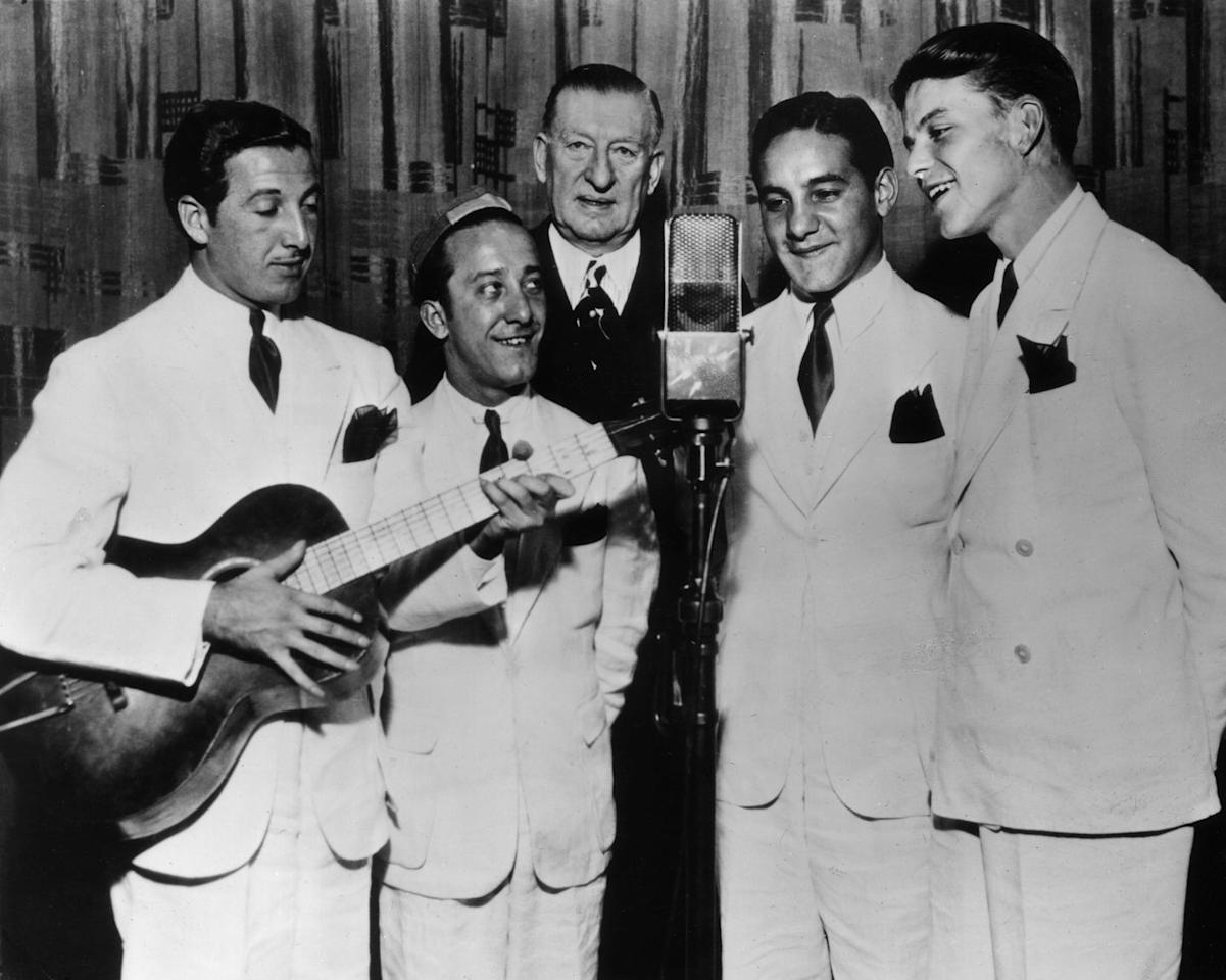 <p>Sinatra (far right) joined his first singing group, dubbed the Hoboken Four, in 1935. To make ends meet, he also worked as a singing waiter. </p>