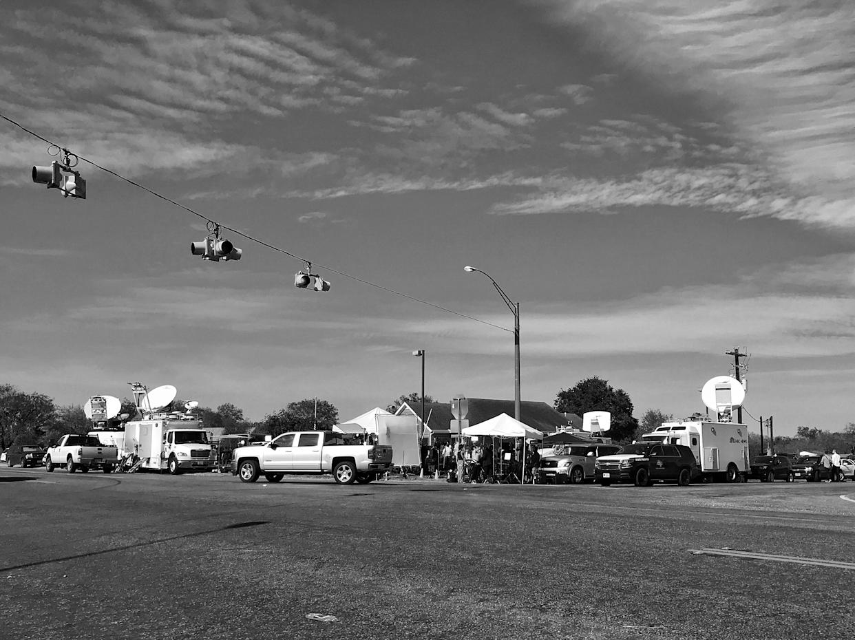 Media trucks crowd the only major intersection in Sutherland Springs, Texas, a tiny one-stoplight town that was the site of a mass shooting on Sunday. (Photo: Holly Bailey/Yahoo News)