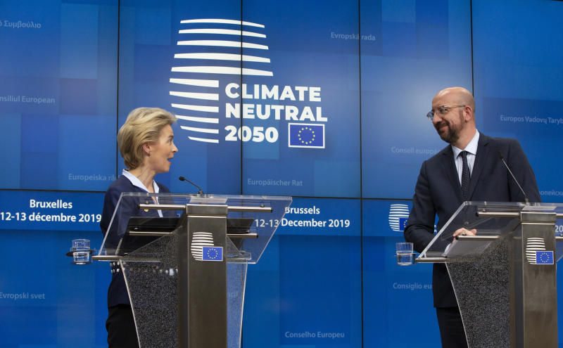 European Council President Ursula von der Leyen, left, and European Council President Charles Michel participate in a media conference during an EU summit in Brussels, Friday, Dec. 13, 2019. European Union leaders gathered for their year-end summit and discussed climate change funding, the departure of the UK from the bloc and their next 7-year budget. (AP Photo/Virginia Mayo)
