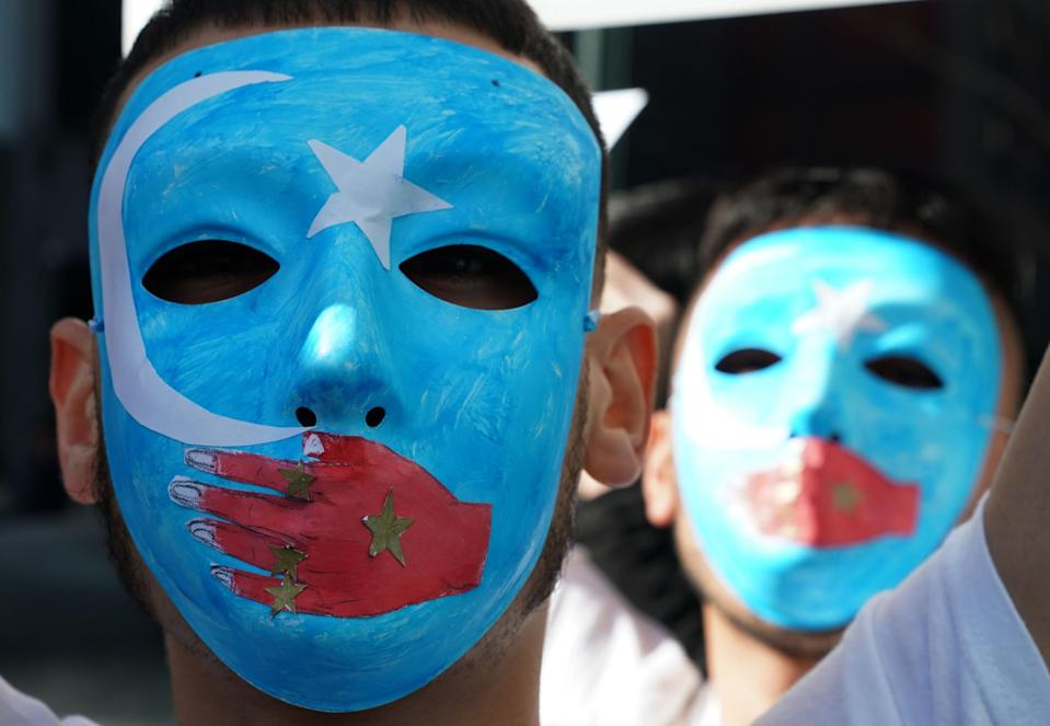 <p>Pro-Uighur protesters outside the United Nations in New York</p> (AFP/ Getty)