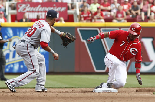Cincinnati Reds' Ramon Santiago (7) comes up at second base for a double in front of Washington Nationals shortstop Ian Desmond (20) in the fourth inning of a baseball game on Saturday, July 26, 2014, in Cincinnati. (AP Photo/David Kohl)