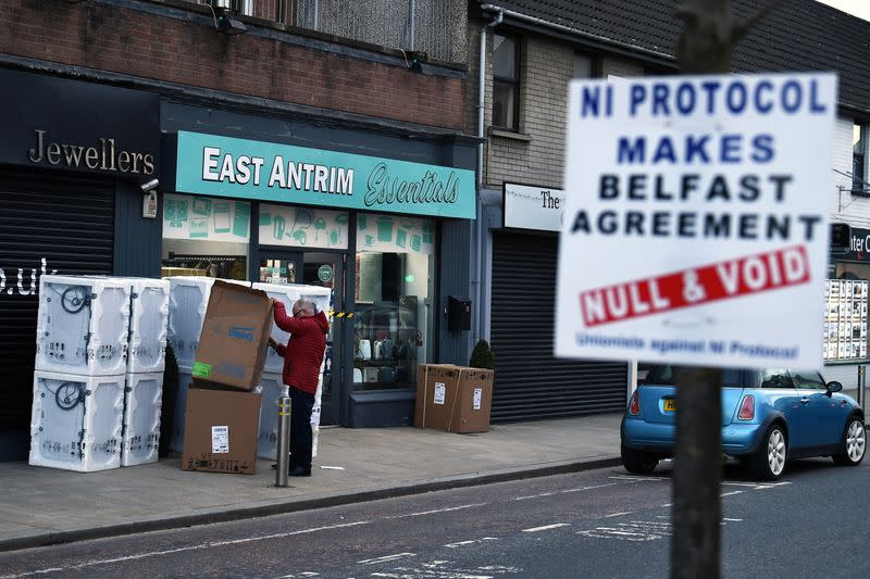 A sign is seen with a message against the Brexit border checks in relation to the Northern Ireland protocol in Larne