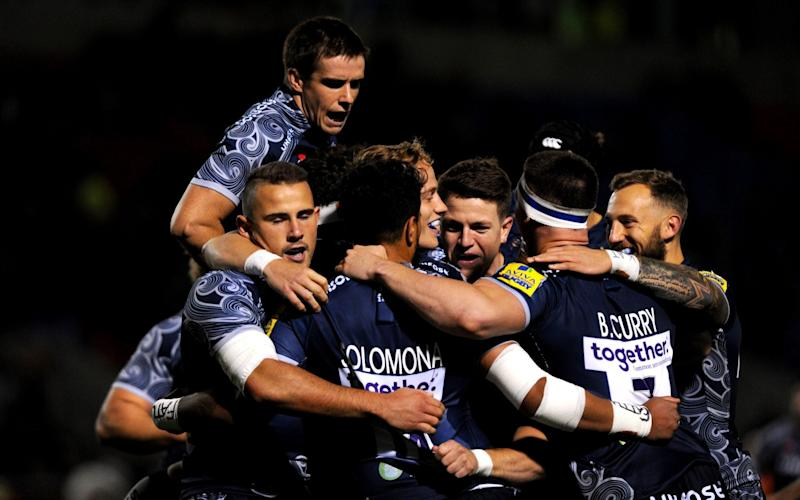 Denny Solomona of Sale Sharks celebrates with his team mates after scoring the first try during the Aviva Premiership match between Sale Sharks and Gloucester Rugby at AJ Bell Stadium on September 29, 2017 in Salford, England - Nathan Stirk/Getty Images