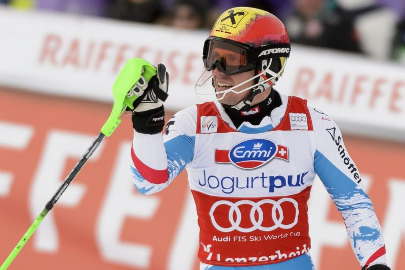 Marcel Hirscher of Austria reacts in the fnish area during the 1st run of the men's World Cup Slalom at the FIS Alpine Ski World Cup finals, in Parpan - Lenzerheide, Switzerland, Sunday, March 17, 2013. (AP Photo/Keystone/Laurent Gillieron)