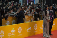 Fans react to Chinese actress Fan Bingbing and Chinese actor Huang Xiaoming at right as they arrive for the 4th Beijing International Film Festival held in Beijing, China, April 16, 2014. Hugely popular online games and celebrity culture are the latest targets in the ruling Communist Party's campaign to encourage China's public to align their lives with its political and economic goals. (AP Photo/Ng Han Guan)