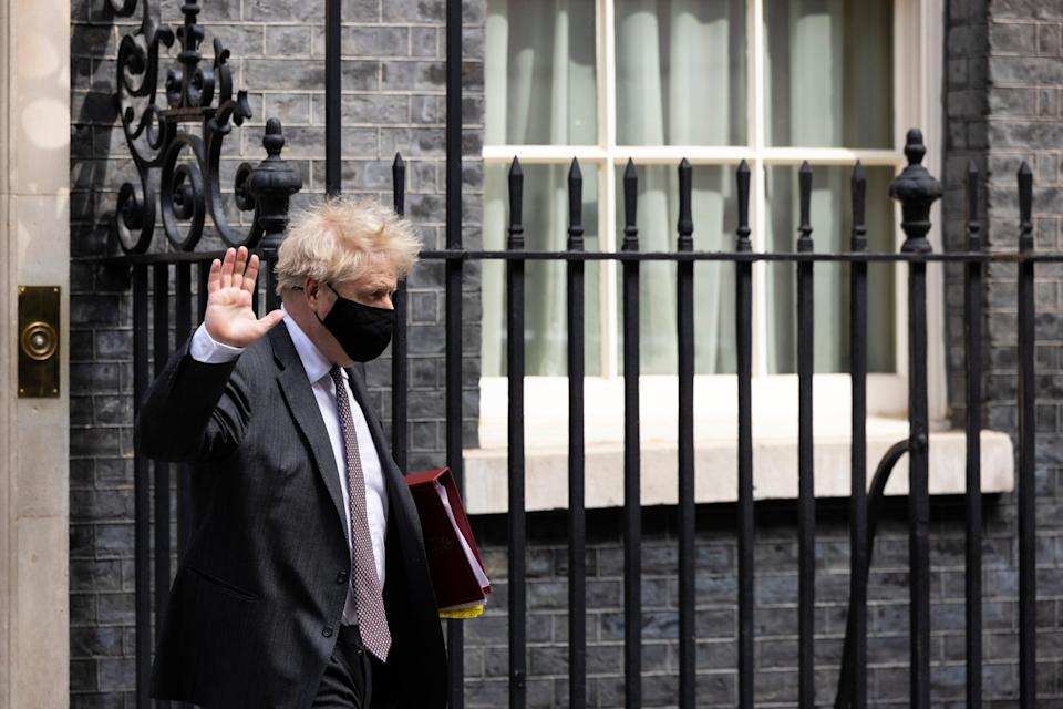 Boris Johnson leaves Downing Street, where his private flat recently underwent a luxury refurbishment (Getty Images)