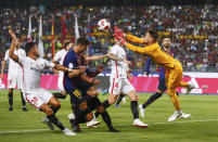 Sevilla goalkeeper Tomas Vaclik, right, leaps for a save during the Spanish Super Cup soccer match between Sevilla and Barcelona in Tangier, Morocco, Sunday, Aug. 12, 2018. (AP Photo/Mosa'ab Elshamy)