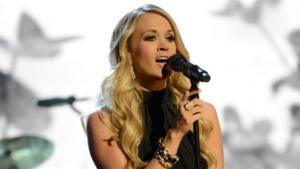 Carrie Underwood Tackles 11 Players for 'Sunday Night Football' Video