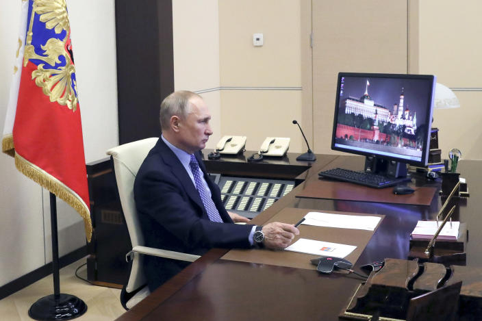 Russian President Vladimir Putin chairs a meeting with Russian regional officials via videoconference at the Novo-Ogaryovo residence outside Moscow, Russia, Monday, March 30, 2020. Putin says the country has managed to slow down the spread of coronavirus but should be prepared for contagions to grow quickly. The new coronavirus causes mild or moderate symptoms for most people, but for some, especially older adults and people with existing health problems, it can cause more severe illness or death. (Mikhail Klimentyev, Sputnik, Kremlin Pool Photo via AP)