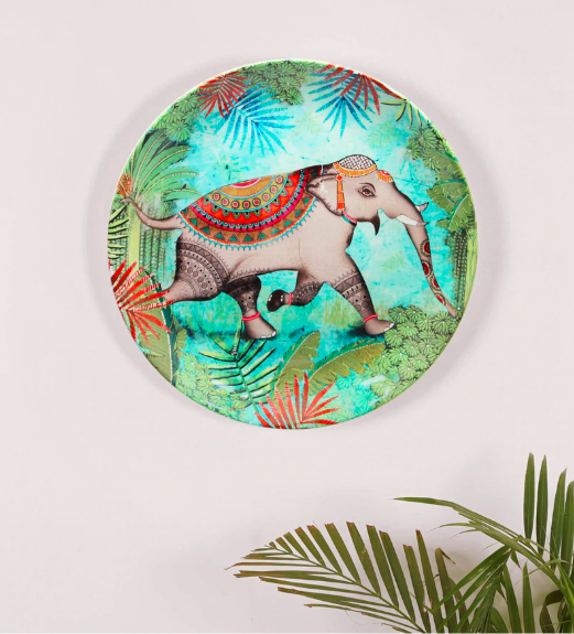 "This 10-inch, bone china <a href=""https://fave.co/2r2soJt"" rel=""nofollow noopener"" target=""_blank"" data-ylk=""slk:Elephant wall plate by Kolorobia"" class=""link rapid-noclick-resp""><strong>Elephant wall plate by Kolorobia</strong></a> was inspired by the flora and fauna of Sri Lanka. <em>Rs.1,489 on offer. </em><a href=""https://fave.co/2r2soJt"" rel=""nofollow noopener"" target=""_blank"" data-ylk=""slk:Flash sale!"" class=""link rapid-noclick-resp""><strong>Flash sale!</strong></a>"