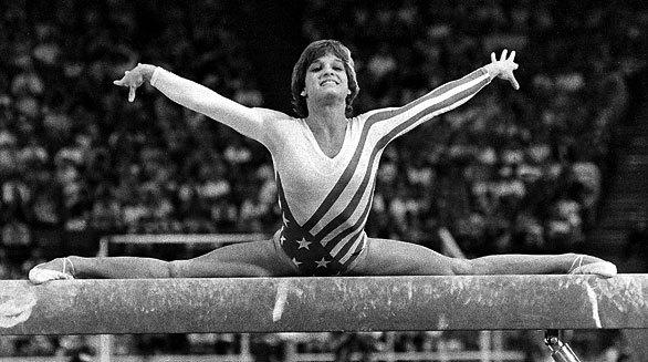 Mary Lou Retton performs on the balance beam.