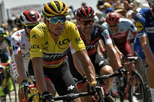 Belgium's Greg Van Avermaet, wearing the overall leader's yellow jersey, and riders take the start of the fourth stage