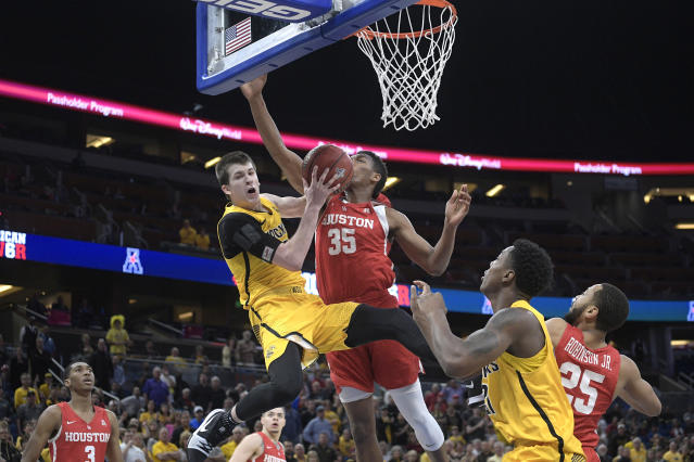 FILE - In this Saturday, March 10, 2018, file photo, Wichita State guard Austin Reaves (12) is fouled by Houston forward Fabian White Jr. (35) while going up for a shot during the second half of an NCAA college basketball game in the semifinals at the American Athletic Conference tournament in Orlando, Fla. Reaves is preparing for a big role with Oklahoma after transferring from Wichita State and sitting out last season. (AP Photo/Phelan M. Ebenhack, File)