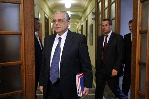 Greek Prime Minister Lucas Papademos arrives for the cabinet meeting at the Greek Parliament in Athens