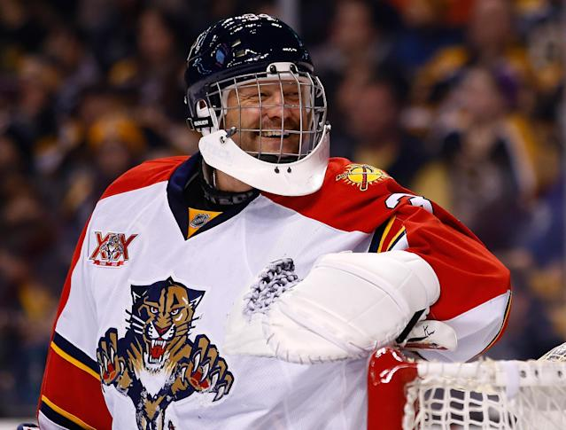 BOSTON, MA - MARCH 04: Tim Thomas #34 of the Florida Panthers laughs following a save in the first period against the Boston Bruins during the game at TD Garden on March 4, 2014 in Boston, Massachusetts. (Photo by Jared Wickerham/Getty Images)
