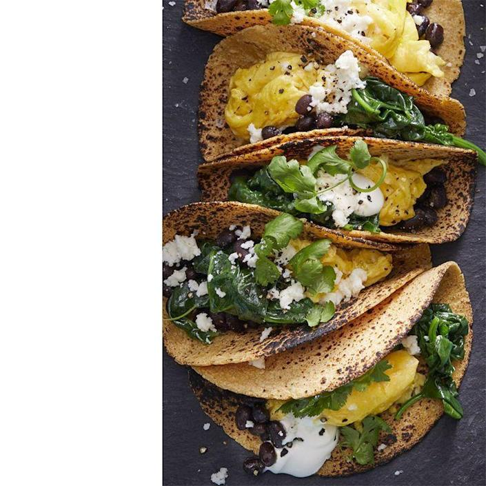 """<p>You just can't go wrong with tacos. Follow the recipe or play with it by adding in some of dad's favorite breakfast toppings or veggies.</p><p><a href=""""https://www.womansday.com/food-recipes/food-drinks/a16764124/scrambled-egg-tacos-recipe/"""" rel=""""nofollow noopener"""" target=""""_blank"""" data-ylk=""""slk:Get the Scrambled Egg Tacos recipe."""" class=""""link rapid-noclick-resp""""><em>Get the Scrambled Egg Tacos recipe. </em></a></p>"""