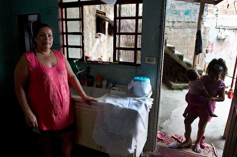 As part of a wave of poor Brazilians to enter a basic sort of middle class in recent years, Monica de Oliveira was a Latin American success story, but for how much longer? (AFP Photo/Nelson Almeida)