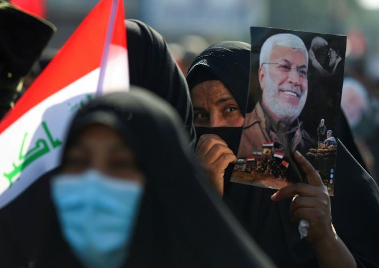 """Pro-Iranian protestors, many dressed in black, massed in Baghdad where they also condemned Iraq's prime minister as a """"coward"""" and an """"agent of the Americans"""""""