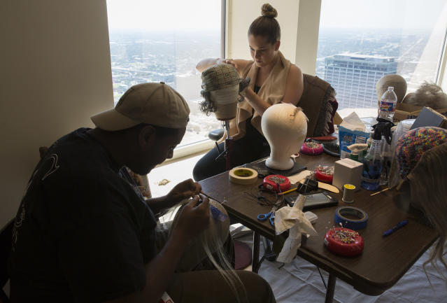 """Wigs for the Alley Theatre productions of """"Cleo"""" and """"Describe the Night"""" being made on the 55th floor of an empty office space in downtown Houston, on Sept. 8, 2017. The lower levels of the Alley Theatre were flooded by Hurricane Harvey and are undergoing repairs. (Photo: Erich Schlegel for Yahoo News)"""