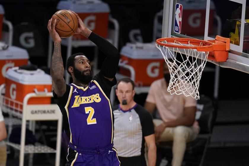 Los Angeles Lakers center Andre Drummond (2) dunks against the Sacramento Kings during the second half of an NBA basketball game Friday, April 30, 2021, in Los Angeles. (AP Photo/Marcio Jose Sanchez)