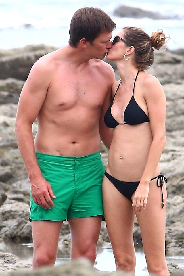 <span>Tom Brady, pictured with wife Gisele, is being body-shamed for his swimsuit photos. (Photo: CPR/Backgrid</span>)
