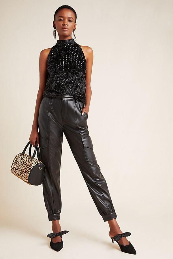 """<p>Try something different and rock these cargo-inspired <a href=""""https://www.popsugar.com/buy/Priscilla-Faux-Leather-Pants-541919?p_name=%20Priscilla%20Faux%20Leather%20Pants&retailer=anthropologie.com&pid=541919&price=140&evar1=fab%3Aus&evar9=47129461&evar98=https%3A%2F%2Fwww.popsugar.com%2Fphoto-gallery%2F47129461%2Fimage%2F47129667%2FPriscilla-Faux-Leather-Pants&list1=shopping%2Cwinter%2Cpants%2Cleather%2Cwinter%20fashion%2Cfashion%20shopping&prop13=api&pdata=1"""" rel=""""nofollow"""" data-shoppable-link=""""1"""" target=""""_blank"""" class=""""ga-track"""" data-ga-category=""""Related"""" data-ga-label=""""https://www.anthropologie.com/shop/priscilla-faux-leather-pants?color=001&amp;q=Priscilla%20Faux%20Leather%20Pants&amp;quantity=1&amp;type=STANDARD"""" data-ga-action=""""In-Line Links""""> Priscilla Faux Leather Pants </a> ($140).</p>"""