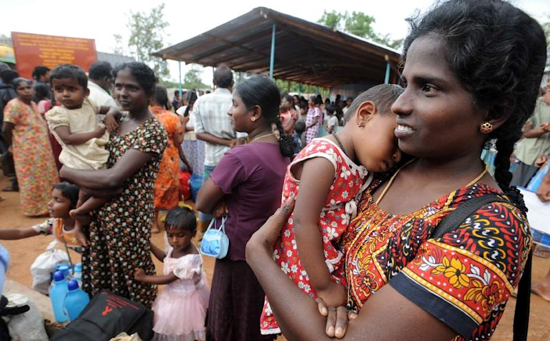 A Tamil woman holds a baby girl at a camp for internally displaced people in the northern town of Vavuniya (AFP Photo/Lakruwan Wanniarachchi)