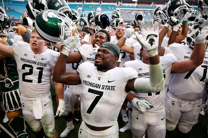 Michigan State safety Michael Dowell (7) celebrates after the Spartans defeated Miami, 38-17, on Saturday, Sept. 18, 2021, in Miami Gardens, Fla.