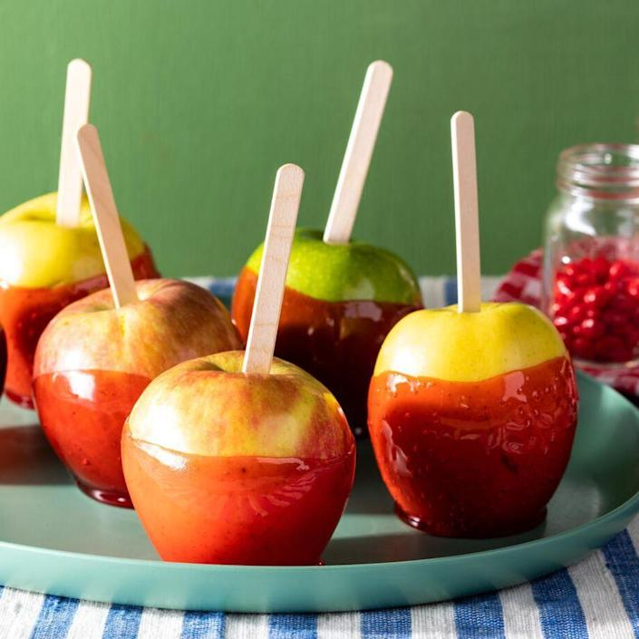 """<p>These candy-coated apples scream fall! To give them their ruby red color and a subtle spiced kick, they're coated in red cinnamon candies (like Red Hots). </p><p><a href=""""https://www.thepioneerwoman.com/food-cooking/recipes/a37002398/candy-apples-recipe/"""" rel=""""nofollow noopener"""" target=""""_blank"""" data-ylk=""""slk:Get the recipe."""" class=""""link rapid-noclick-resp""""><strong>Get the recipe.</strong></a></p>"""