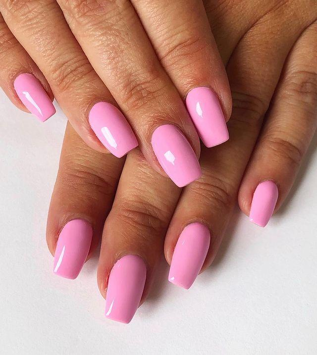 """<p>Go Pepto-Bismol pink with a creme polish and high shine top coat.</p><p><a href=""""https://www.instagram.com/p/B0-gmj9l8yA/"""" rel=""""nofollow noopener"""" target=""""_blank"""" data-ylk=""""slk:See the original post on Instagram"""" class=""""link rapid-noclick-resp"""">See the original post on Instagram</a></p>"""