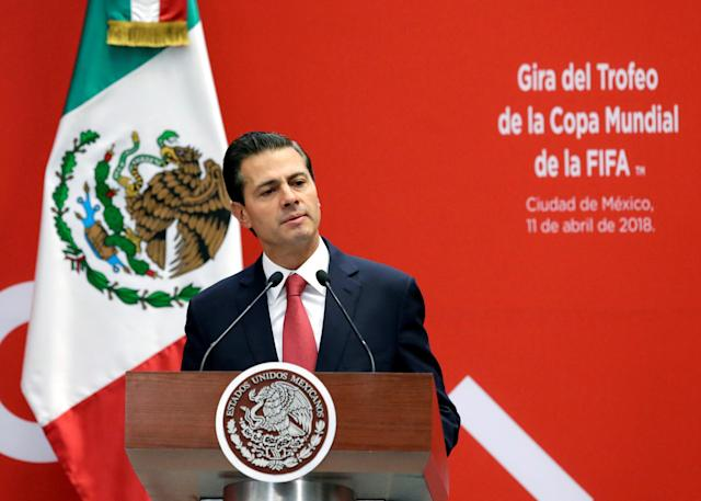 Mexican President Enrique Pena Nieto gives a speech during a ceremony of a global tour of the FIFA World Cup trophy, at Los Pinos presidential residence in Mexico City, Mexico April 11, 2018. REUTERS/Henry Romero