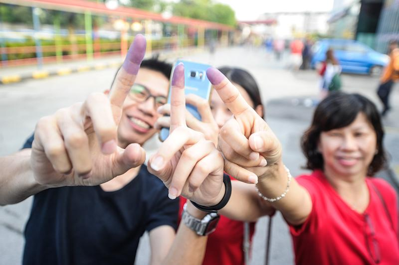 People show their ink-stained fingers after casting their ballots during the Balakong by-election at SJK(C) Batu 11 Cheras in Kuala Lumpur September 8, 2018. — Picture by Shafwan Zaidon