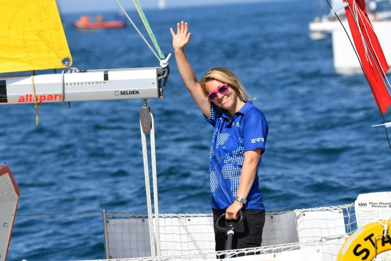 British sailor Susie Goodall -- seen here waving from her yacht, the DHL Starlight -- is back on dry land after her yacht was crippled in a major storm, forcing her rescue at sea
