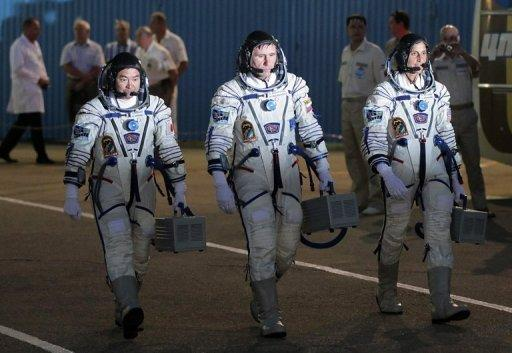 Astronauts Yuri Malenchenko (C) of Russia, Sunita Williams (R) of the US and Akihiko Hoshide (L) of Japan during a sending-off ceremony before the launch of the the Soyuz TMA-05M spacecraft at the Russian-leased Baikonur cosmodrome on July 15. The trio started their journey on top of the Soyuz-FG rocket under the clear blue sky of the Kazakh steppe on schedule at 0240 GMT