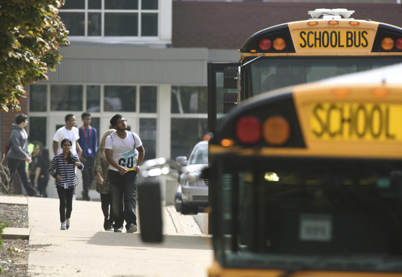 Warren Fitzgerald High School students are released from lockdown after a student was stabbed on campus Wednesday, Sept. 12, 2018, in Warren, Mich. (Max Ortiz/Detroit News via AP)