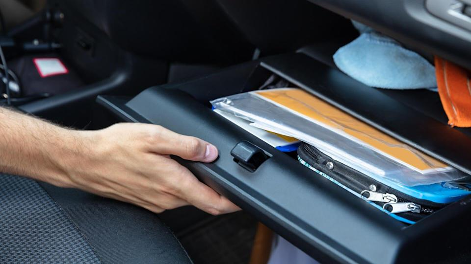 Driver Hand Opening Glovebox Compartment Inside Car.