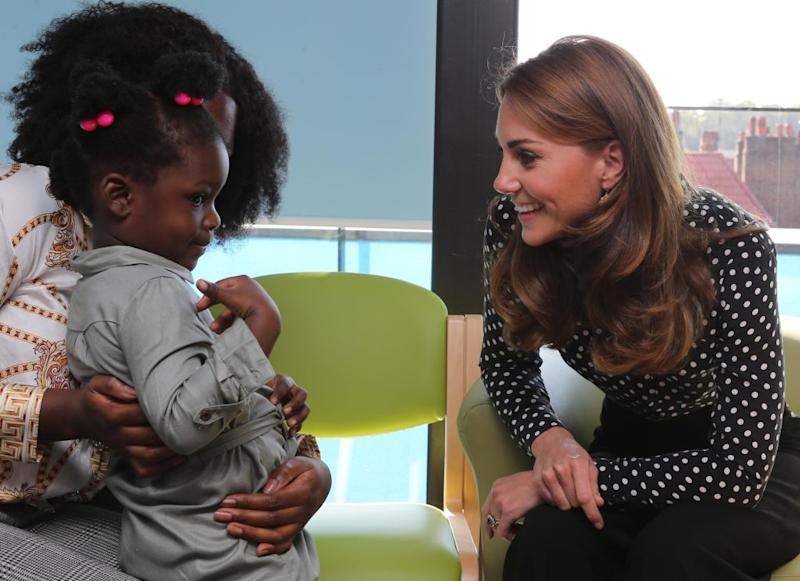 The Duchess of Cambridge chatted to young mothers and their children at a visit to the Sunshine House Children and Young People's Health and Development Centre [Photo: Getty]