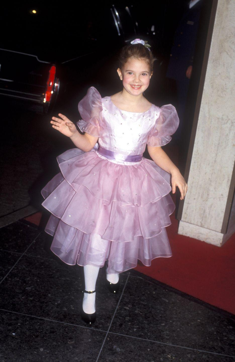 <p>Drew Barrymore circa 1983 couldn't have been any cuter in this pink dress. </p>