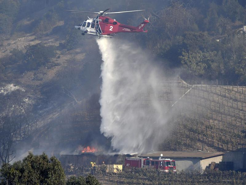 LA city firefighters try to save a winery storage building that is own by billionaire Rupert Murdoch: Rex Features