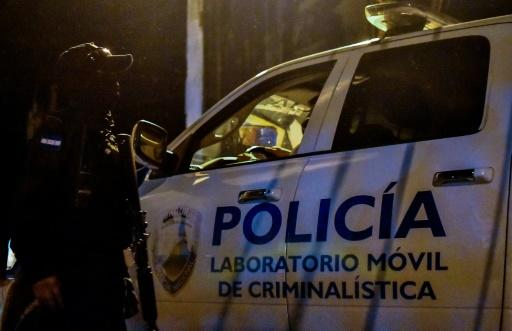 Forensic police arrive at the Tela prison in Honduras, where overnight fighting between rival gangs claimed at least 18 lives, officials said