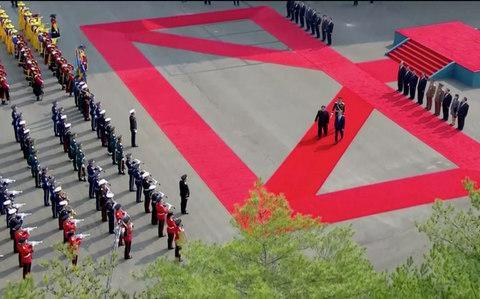 <span>The two leaders take part in the red carpet ceremony at the DMZ</span> <span>Credit: Reuters </span>
