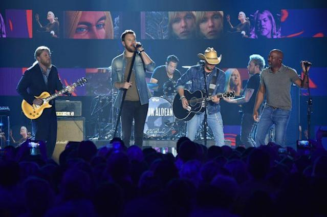 Derek Trucks, Charles Kelley of Lady Antebellum, Jason Aldean, and Darius Rucker perform onstage during the 2017 CMT Music Awards at the Music City Center on June 6, 2017 in Nashville, Tennessee. (Photo by Michael Loccisano/Getty Images for CMT)