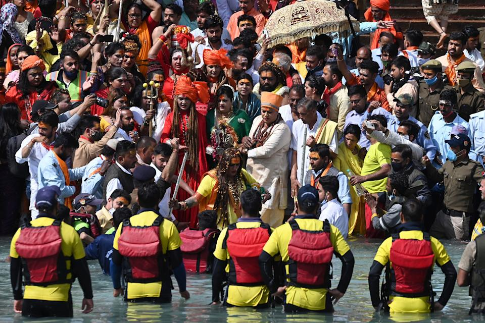 Followers of the Kinnar Akhara monastic Hindu order made up of transgender members take a holy dip in the waters of the River Ganges on the Shahi snan (grand bath) on the occasion of Maha Shivratri festival during the ongoing religious Kumbh Mela festival in Haridwar on March 11, 2021. (Photo by Prakash SINGH / AFP) (Photo by PRAKASH SINGH/AFP via Getty Images)