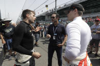 FILE - In this May 16, 2019, file photo, NASCAR driver Jimmie Johnson, center, talks with Will Power, left, of Australia, and Josef Newgarden during practice for the Indianapolis 500 IndyCar auto race at Indianapolis Motor Speedway in Indianapolis. NASCAR seven-time champion Jimmie Johnson will test an Indy car next week on the road course at Indianapolis Motor Speedway. Hes long said he is open to racing in the series but did not want to compete on ovals out of safety concerns. On Friday, July 3, 2020, he indicated recent safety improvements have softened his stance and the Indianapolis 500 is not entirely out of the picture(AP Photo/Darron Cummings)
