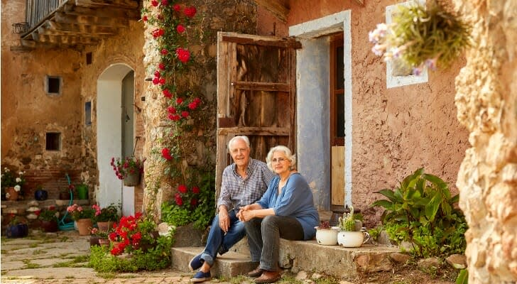 Older couple in front of an investment property