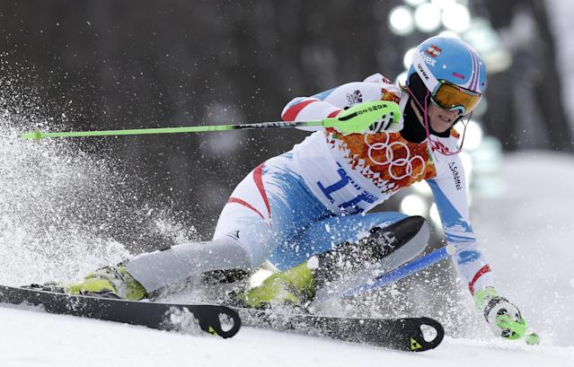 Silver medalist Austria's Nicole Hosp passes a gate in the slalom portion of the women's supercombined at the Sochi 2014 Winter Olympics, Monday, Feb. 10, 2014, in Krasnaya Polyana, Russia. (AP Photo/Luca Bruno)