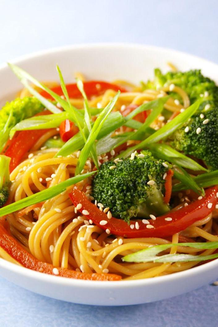 "<p>An easy way to make your favorite take-out.</p><p>Get the recipe from <a href=""https://www.delish.com/cooking/recipe-ideas/recipes/a56052/spaghetti-lo-mein-recipe/"" rel=""nofollow noopener"" target=""_blank"" data-ylk=""slk:Delish"" class=""link rapid-noclick-resp"">Delish</a>. </p>"