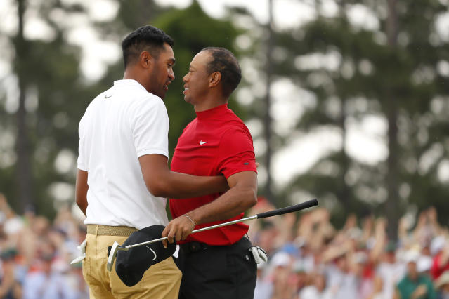 Tony Finau of the United States congratulates Tiger Woods of the United States on his win on the 18th green during the final round of the Masters at Augusta National Golf Club on April 14, 2019 in Augusta, Georgia. (Photo by Kevin C. Cox/Getty Images)
